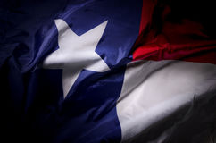 Lone Star flag. The Texas state flag waving in shadow Royalty Free Stock Photography