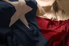 The Lone Star in the forefront. The Texas flag in vintage light and shadow royalty free stock photos