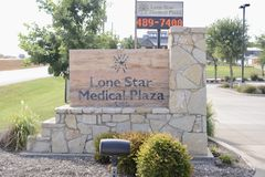 Lone Star Medical Plaza, Fort Worth, Texas. Lone Star Medical Plaza in Fort Worth, Texas provides emergency, urgent and minor medical care to people in need royalty free stock image