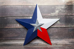 Lone Star. The star of the Texas flag against a wood background Stock Image