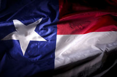 The lone star. The Texas state flag waving in shadow Royalty Free Stock Photo