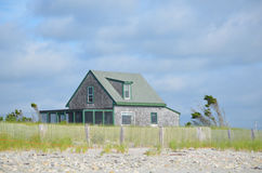 Lone Summer Cottage on Duxbury Beach. Solitary summer cottage on Duxbury beach in Massachusetts Stock Photography