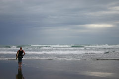 Lone Surfer. A lone surfer checking to see what the weather is like Stock Photo