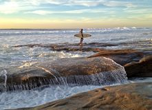 Lone Surfer looks out into the Pacific Ocean Stock Image