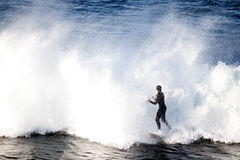 A Lone Surfer tackling huge waves Stock Photo