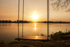 Lone swing at river side and sunset ,Thailand Royalty Free Stock Image