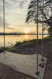 Lone swing at river side and sunset ,Thailand . Vintage Tone. Stock Images