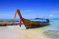 Lone tailboat floating in the clear waters Stock Image