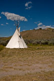 Lone Tepee. A reproduction Native American tepee is erected as part of a historical western reenactment of life in a western mining town.  The reenactment takes Royalty Free Stock Photo