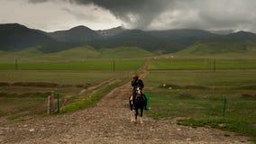 Lone Tibetan rider Stock Photo