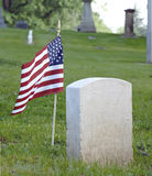 Lone Tombstone with Flag. Lone Civil War tombstone with American flag Royalty Free Stock Image