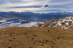 Lone tourist descend from the mountains. Nature stock photography
