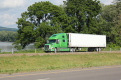 Lone tractor-trailer on an interstate highway. Royalty Free Stock Image