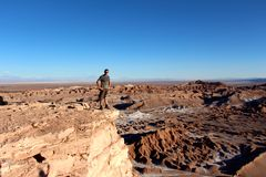 Lone traveler looking over Valle de la Luna chile. Valle de la Luna - The Moon Valley - in the Atacama Desert, Chile Royalty Free Stock Photography