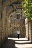 Lone traveler in the Old Town of Jerusalem Stock Images