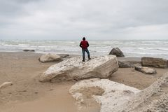 Lone traveler by the sea royalty free stock photos