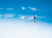 Lone traveller on Salar De Uyuni Royalty Free Stock Image