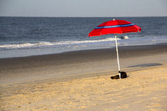 Lone Umbrella on Beach Stock Image