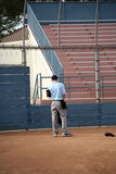 Lone umpire. Umpire alone on the field royalty free stock image