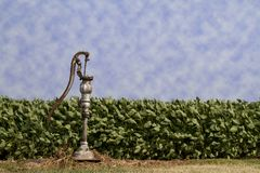 Lone Well Water Hand Pump - Landscape Stock Photo
