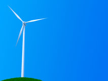 Lone wind turbine. Wind turbine on blue background on the top of a grassy hill Royalty Free Stock Images