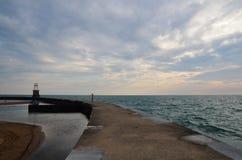 Lone woman at Lake Michigan Stock Photo