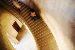 Lone woman in stairs Stock Images