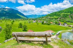 A lone wooden bench stands on top. Of a mountain Royalty Free Stock Photos