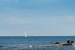 Lone yacht sailing the ocean Stock Image