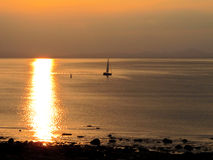 Lone Yacht in the sunset. Royalty Free Stock Image