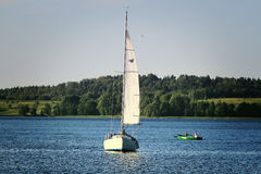 Lone yacht in Trakai lake Stock Photos