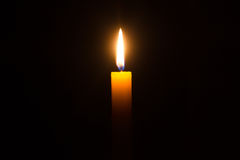 Lone yellow candle Stock Photo