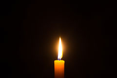 Lone yellow candle Stock Image