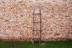 Loneliness. Old ladder at the wall Royalty Free Stock Image