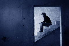 Loneliness. Lonely girl standing on the stairs of a deserted building Royalty Free Stock Photography