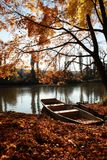 Loneliness. Once upon a time, there was a small lonely boat on lake. It was early autumn Stock Image