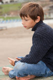 Loneliness. Lonely little boy at the beach Stock Photography