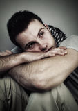Loneliness. Young man who is lonely and desolate-High contrast image Stock Images