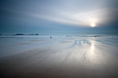 Loneliness. Rhossili Bay beach Gower Wales UK Stock Photography