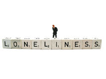 Loneliness. A lonesome man behind the word loneliness royalty free stock image