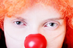 Loneliness. Slose-up portrait of redhead clown with sad blue eyes Royalty Free Stock Photography