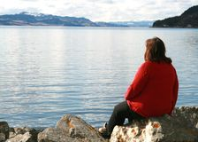 Loneliness. Lonely overweight woman looking at the ocean Stock Photography
