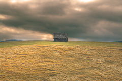 Loneliness. Lonely hut in a mountain area with a dramatic heavy sky.Location: Paltinis,Romania Stock Photo