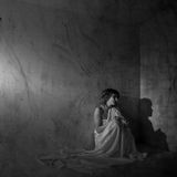 Loneliness. Sad lonely woman at a wall Stock Image