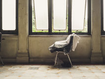 Loneliness chair by the windows. Stock Photos