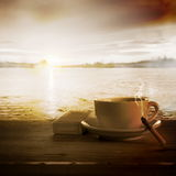 Loneliness. Coffee and Cigarette Burning Down Stock Images