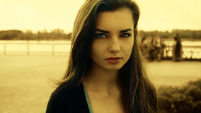 Loneliness, deep look of young unhappy  girl with river on background vintage color, toned shot Stock Images