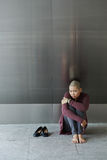 Loneliness. Depressed crying woman sitting on the floor Stock Images