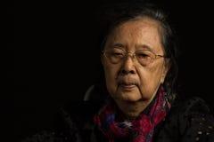 Loneliness elder woman Stock Photography