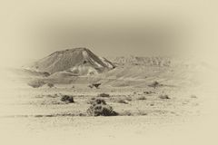 Loneliness and emptiness of the desert. Loneliness and emptiness of the rocky hills of the Negev Desert in Israel. Breathtaking landscape and nature of the royalty free stock images